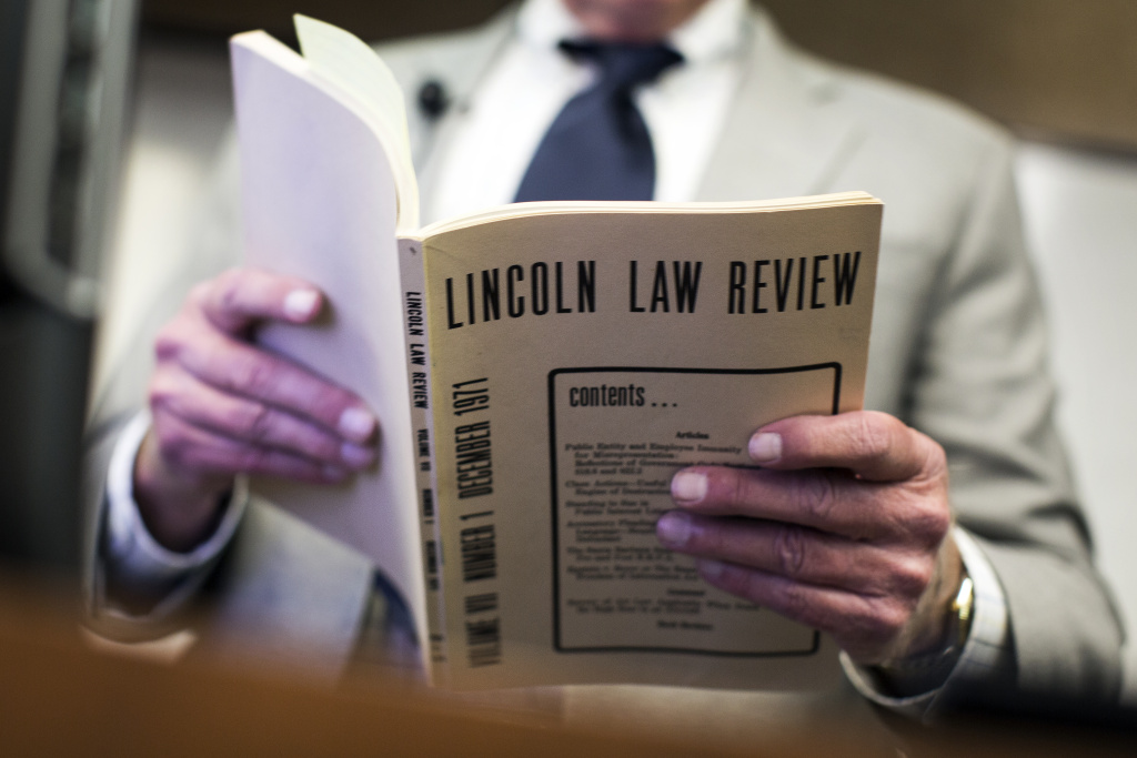 Bob Hutchinson is a partner at Cotchett, Pitre & McCarthy LLP. Hutchinson reads an excerpt from Lincoln Law Review that he wrote in 1971 during a town hall meeting on toxic PCBs inside Malibu public schools at Pepperdine Law School on Tuesday evening, March 1, 2016. Hutchinson handled lead paint lawsuits.