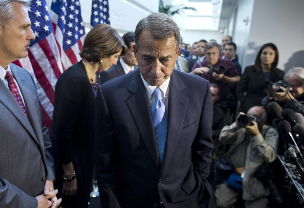 House Speaker John Boehner, R-Ohio, walks away from the microphone during a news conference after a House GOP meeting on Capitol Hill,  Tuesday, Oct. 15, 2013, in Washington. House GOP leaders Tuesday floated a plan to fellow Republicans to counter an emerging Senate deal to reopen the government and forestall an economy-rattling default on U.S. obligations. But Republican divisions forced GOP leaders to drop efforts to ram their own version through the House.