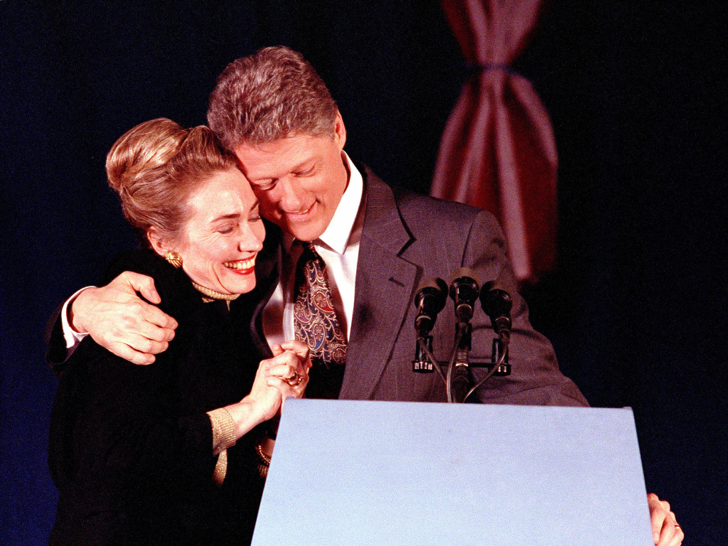 Bill Clinton hugs his wife Hillary at his election night party in New Hampshire in 1992. Clinton finished second, but after an even worse showing in Iowa, he declared himself the
