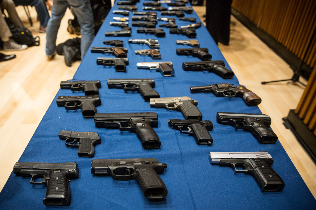Guns seized by the New York Police Department (NYPD), in the largest seizure of illegal guns in the city's history, are displayed on a table during a press conference on August 19, 2013 in New York City.