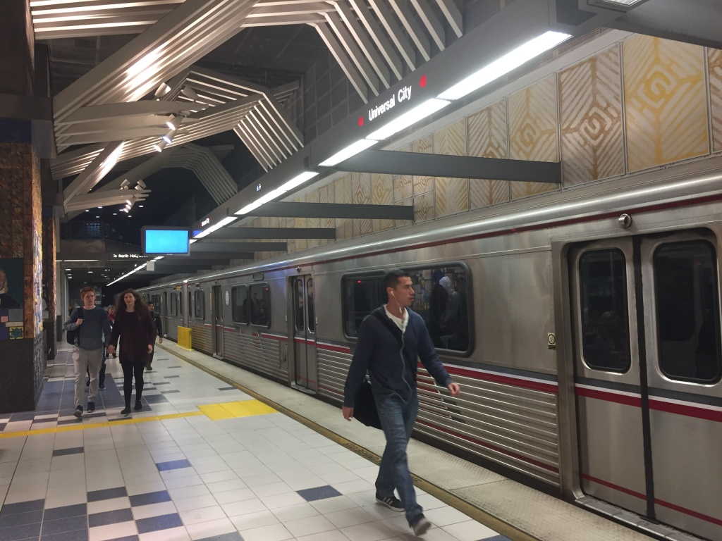 Passengers exit the Red Line at the Universal City station on Dec. 6, 2016. Law enforcement authorities ordered additional security at the station after receiving information about a non-corroborated bomb threat directed at the Metro stop.