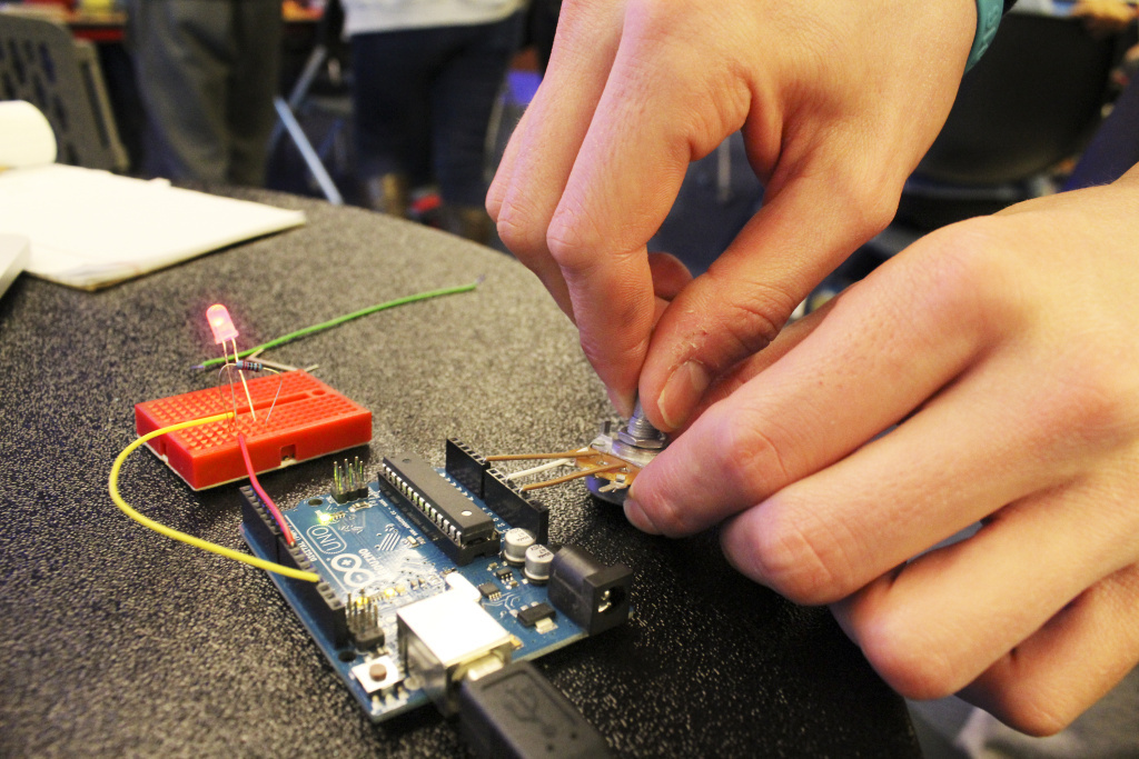 A student works on a light sensor during an Arduino workshop at the Georgetown Hackathon in Washington, D.C.