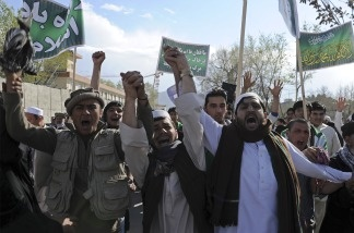 Afghan protesters shout slogans against the US, Israel, and England during a demonstration in Kabul on April 1, 2011.