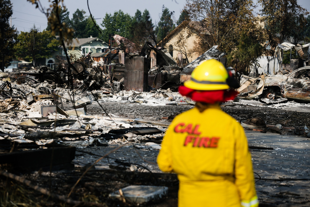 A Cal Fire employee surveys damage caused by the Tubbs Fire in the Coffey Park neighborhood of Santa Rosa, California on October 13, 2017.
