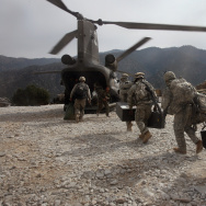 U.S. soldiers board an Army Chinook transport helicopter after it brought fresh soldiers and supplies to the Korengal Outpost October 27, 2008.
