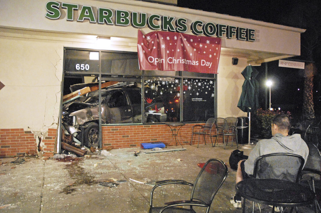 In this photo taken Tuesday, Dec. 13, 2011, an SUV remains in the store after crashing through the wall of a Starbucks in Fillmore, Calif., killing a 30-year-old former Marine and Iraq war veteran.