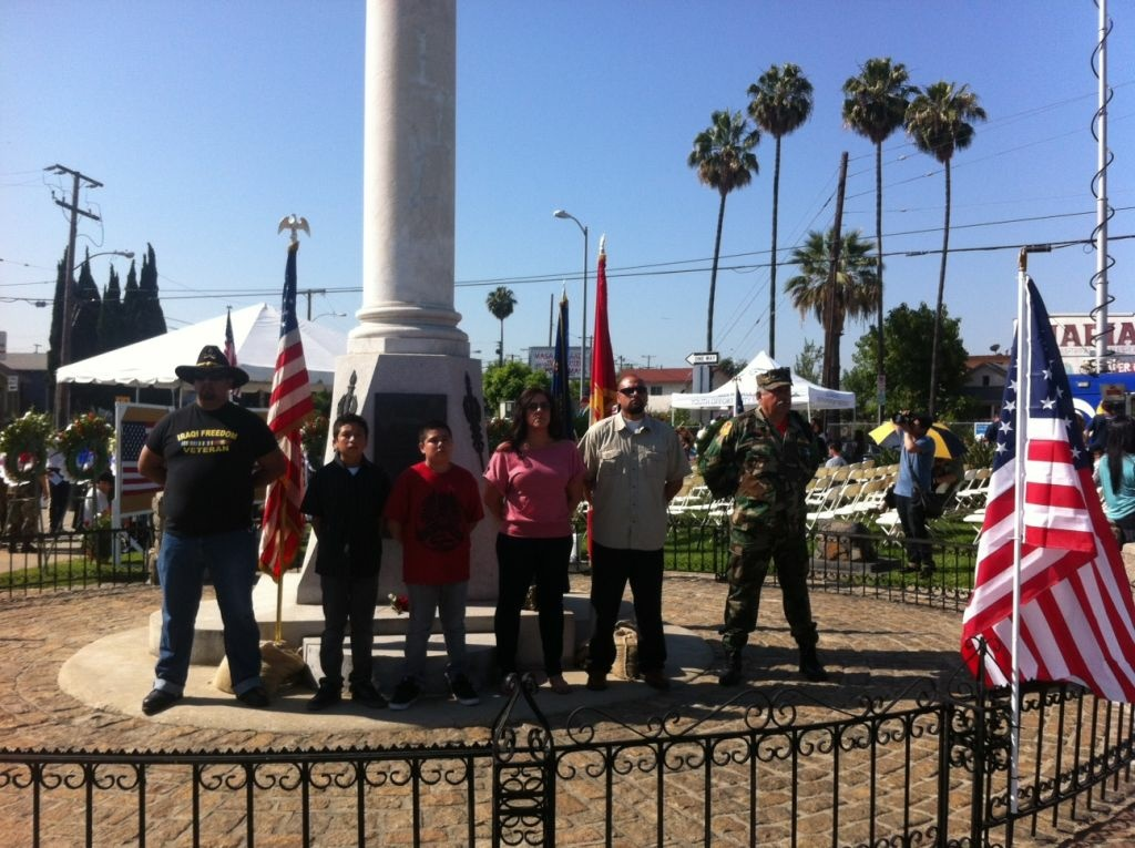 Families honor the contributions of Mexican American soldiers from World War Two to the present at the Cinco Puntos intersection and war memorial.