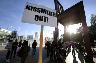 Demonstrators gather at the Place des Nations in Geneva to protest against the presence of former US secretary of state Henry Kissinger and his alleged role in the 1973 military coup in Chile on September 10, 2010.