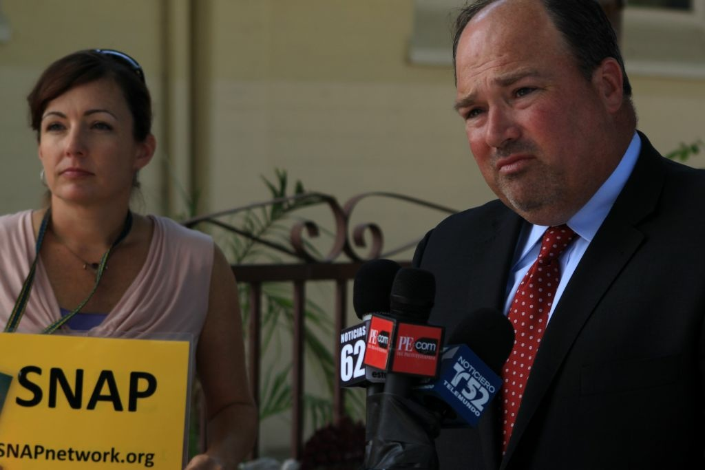 Joelle Casteix (L) and attorney John Manly at news conference announcing lawsuits against Fr. Alex Castillo and the Roman Catholic Diocese of San Bernardino.