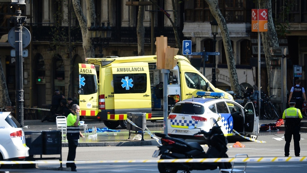 Emergency personnel cordon off the area where a van plowed into a crowd on Las Ramblas boulevard in Barcelona on Thursday.
