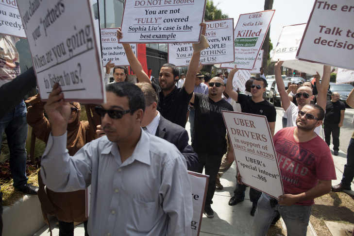 Uber drivers protest outside of corporate offices in Santa Monica. Drivers are upset with various Uber policies, some they say inhibit their ability to earn a decent living.