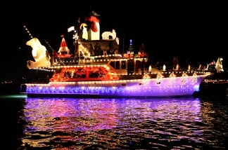 Boats in the annual Newport Beach Christmas Boat Parade are lit with decorations as they move through through the night.