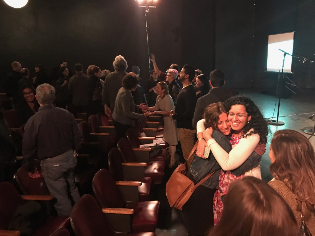 Tasneem Noor, right, hugs an audience member after a recent storytelling event at The Hayworth Theatre in Los Angeles, where Noor was a speaker.