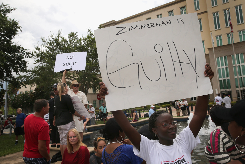 Supporters of Treyvon Martin and George Zimmerman demonstrate in front of the Seminole County Criminal Justice Center as they wait for the verdict to be announced in the George Zimmerman murder trial on July 13, 2013 in Sanford, Florida. The jury found Zimmerman, a neighborhood watch volunteer, not guilty in the February 2012 shooting death of 17-year-old Treyvon Martin.