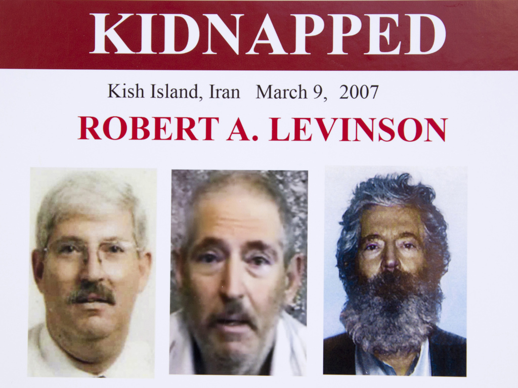 An FBI poster from 2012 showing former FBI agent Robert Levinson before his capture, left; in a video released by his kidnappers, center; and a composite image of what he might look like after five years in captivity, right. The FBI said Levinson was the longest-held American hostage.