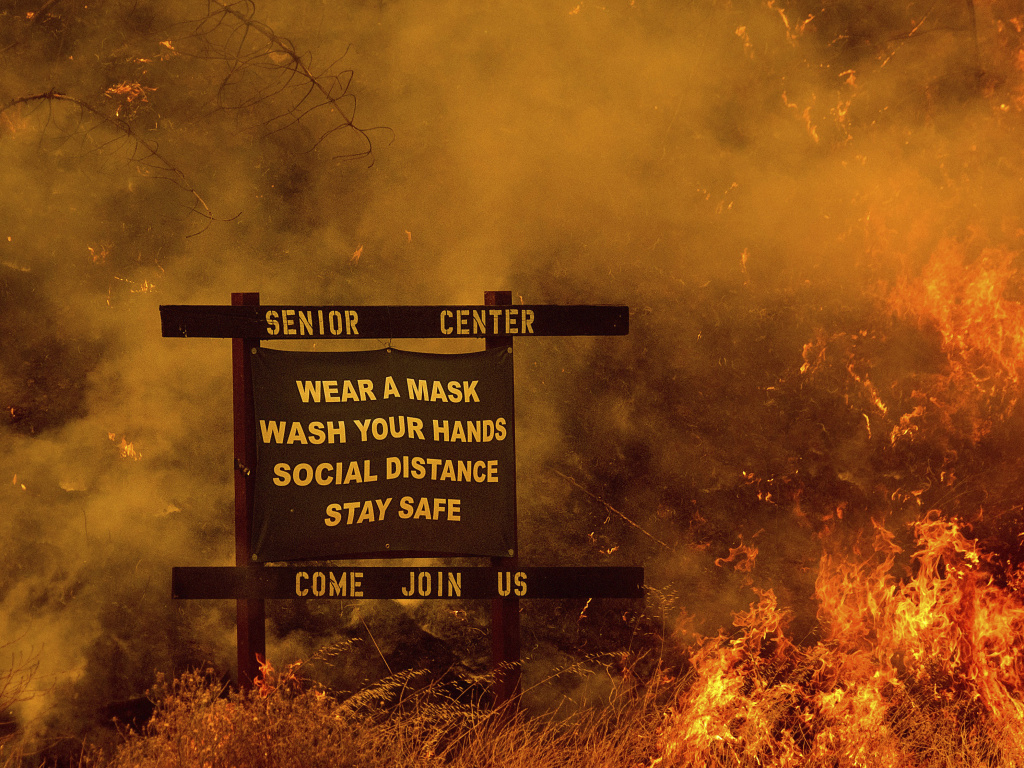Flames from the LNU Lightning Complex fires burn in unincorporated Napa County, Calif., on Tuesday.