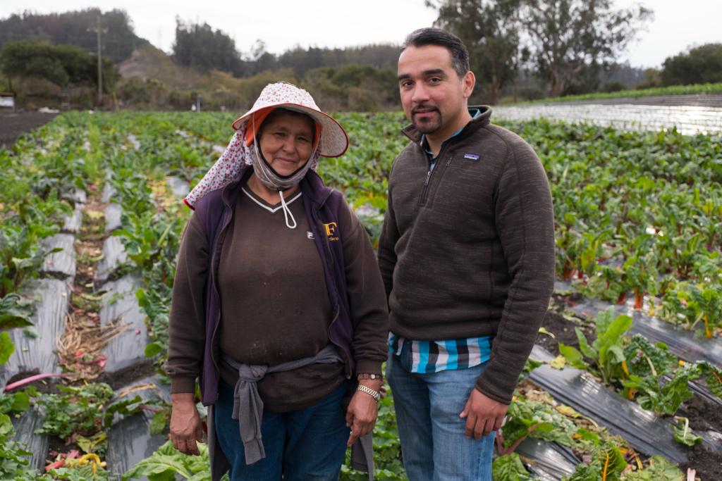 Farm owner Bertha Magaña and her kitchen table advisor, David Mancera, pose at Magaña's farm in Prunedale. Andrew Nixon / Capital Public Radio