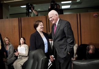 U.S. Supreme Court nominee Elena Kagan speaks with committee chairman Senator Patrick Leahy (D-VT) while she leaves after testifying before the Senate Judiciary Committee on the third day of her confirmation hearings on Capitol Hill June 30, 2010 in Washington, DC.
