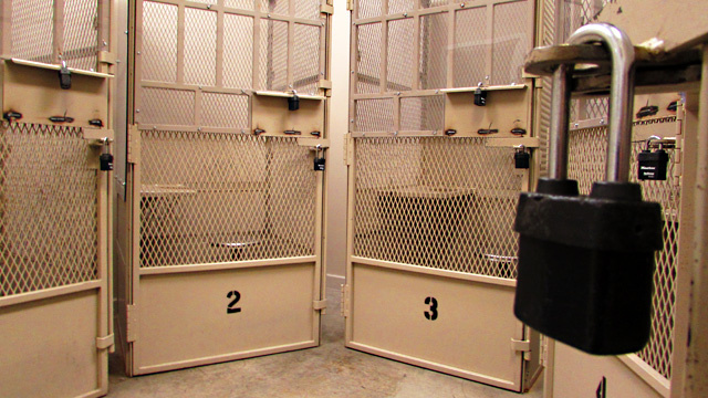During group therapy, inmates are confined in metal cages known as