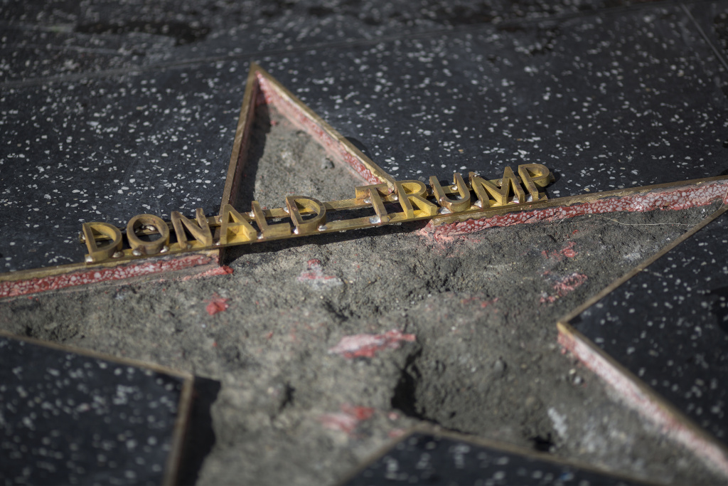File:: The Hollywood Walk of Fame star of Republican presidential candidate Donald Trump is repaired after it was vandalized by a protester on October 26, 2016 in Hollywood, California.