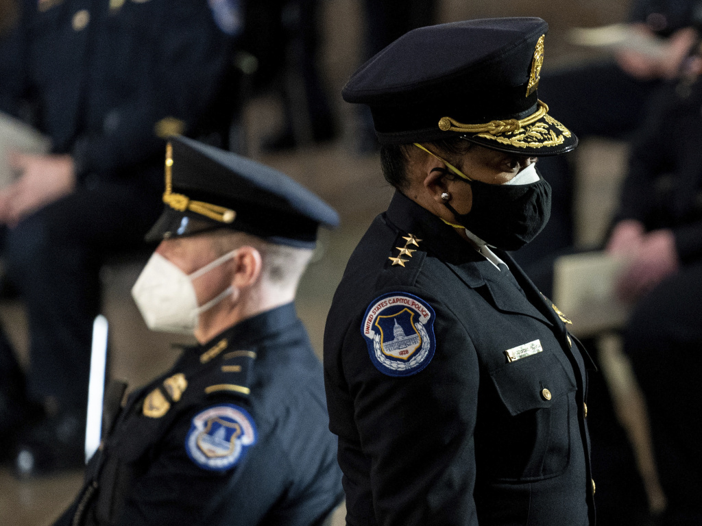 Capitol Police Acting Chief Yogananda Pittman, shown at the right at a ceremony memorializing U.S. Capitol Police officer Brian Sicknick, who was killed on January 6, has come under criticism from rank and file officers for the response to the insurrection.