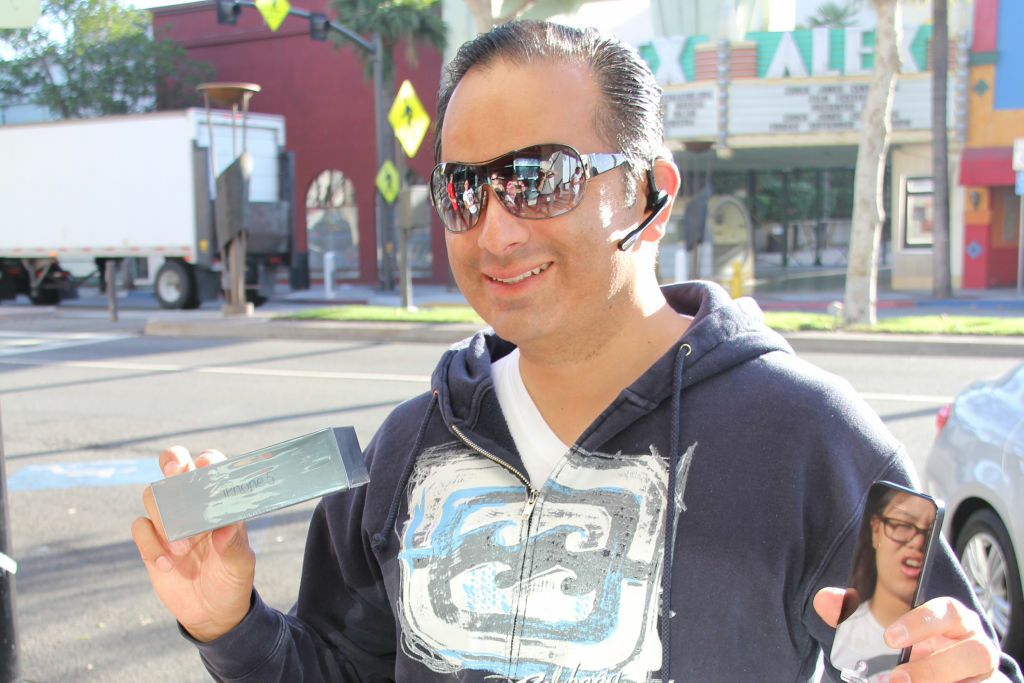 First in line at the Glendale AT&T store, iPhone 5 owner Mark shows off his shiny new gadget.