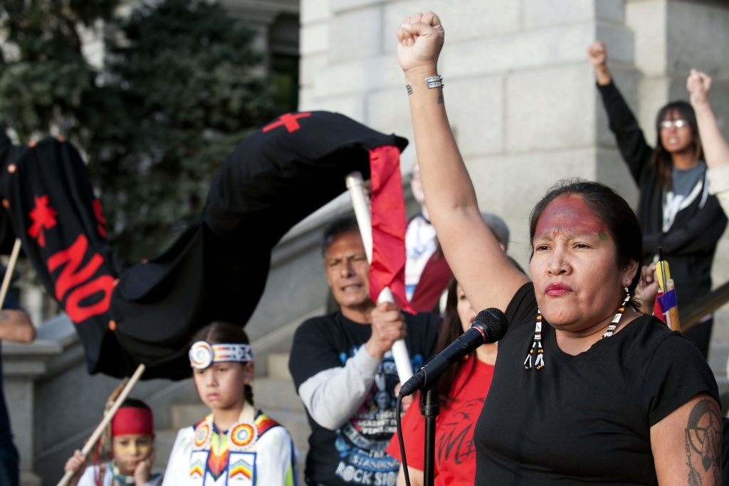 Molly Ryan Kills Enemy of the Sicangu Lakota Nation addresses indigenous rights activists gathered at the Colorado State Capital during the Native Nations March in Denver, Colorado on March 10, 2017.