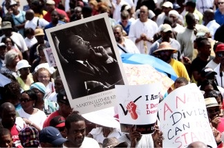 A participant holds up a poster of Martin Luther King, Jr. as marchers wait to leave Dunbar High School for the 'Reclaim the Dream' march to commemorate the 47th anniversary of King's March on Washington, in Washington, D.C. on Aug. 28, 2010.