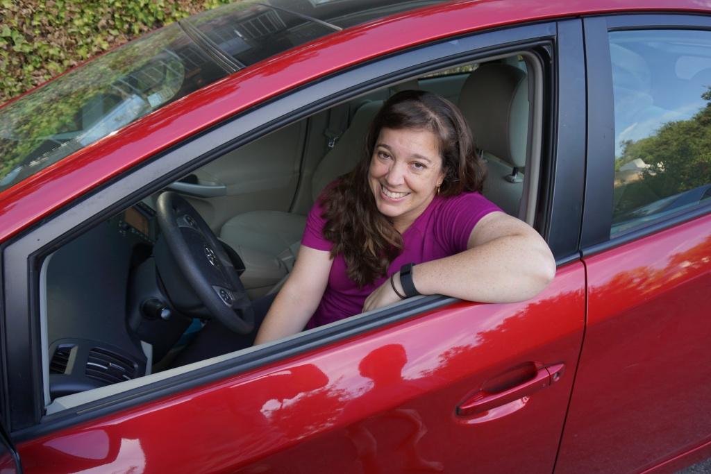 KPCC listener Luisa Rebull sits in her car.