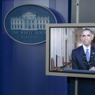 US President Barack Obama is seen on a screen in the White House briefing room during an address to the nation on immigration reform November 20, 2014 in Washington, DC.