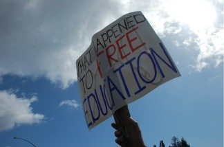 A student protests the University of California's tuition hikes.