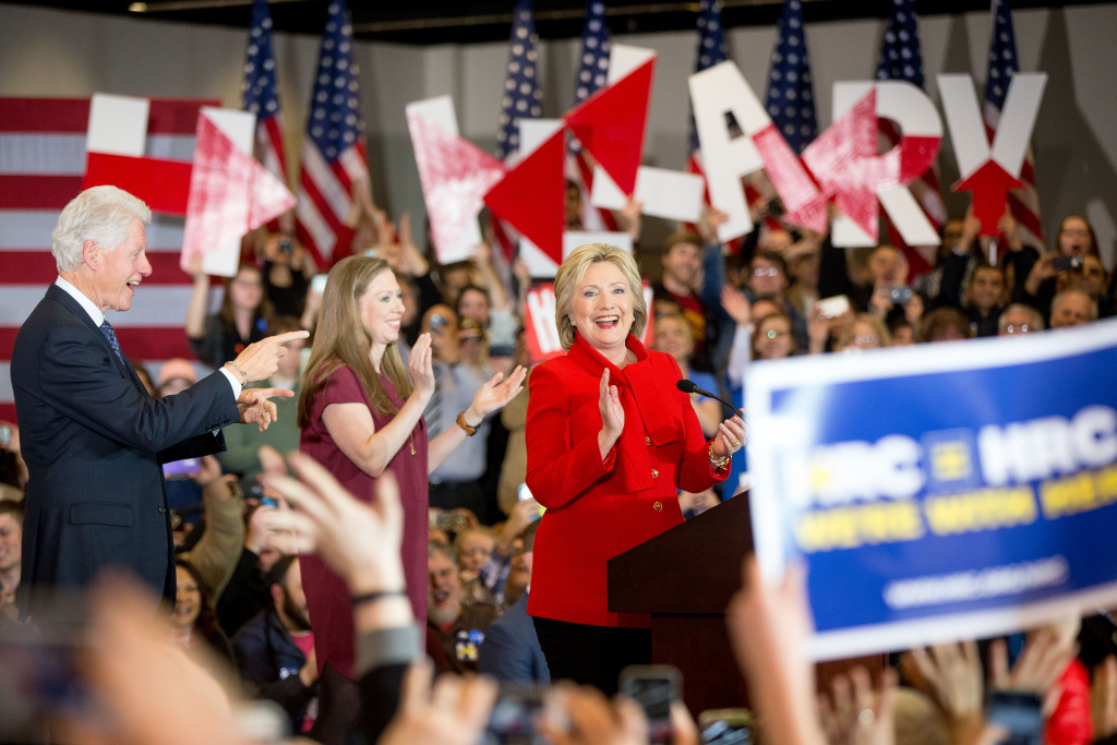 Democratic presidential candidate Hillary Clinton, accompanied by former President Bill Clinton and their daughter Chelsea Clinton, arrives at her caucus night rally at Drake University in Des Moines, Iowa, Monday, Feb. 1, 2016. (AP Photo/Andrew Harnik)
