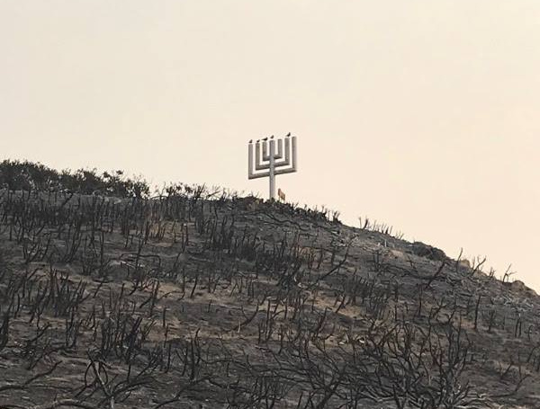 A giant metal menorah overlooking the Pacific Ocean at Camp Hess Kramer in Malibu was one of few structures to survive the Woolsey Fire.