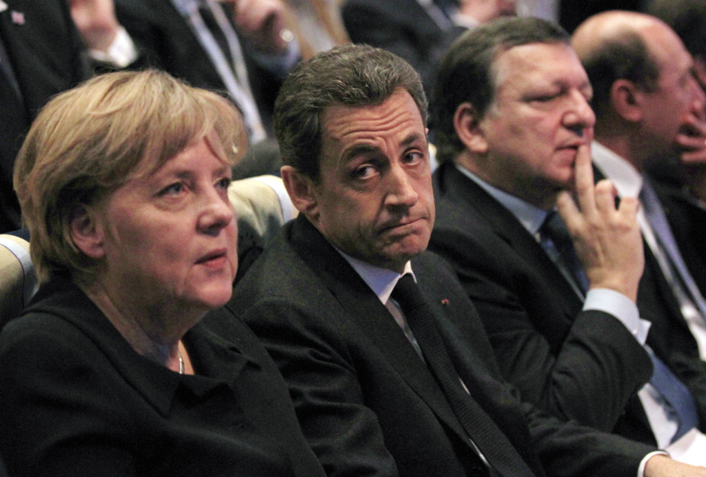 France's President Nicolas Sarkozy (C) sits next to German Chancellor Angela Merkel (L) and European Commission President Jose Manuel Barroso (R) after he delivered his speech at the Conservative European People's Party (EPP) congress in Marseille, on December 8, 2011.