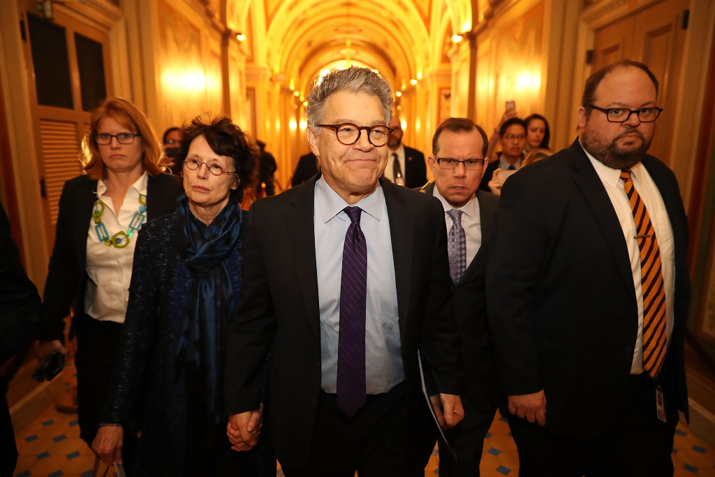 Sen. Al Franken (D-MN) (C) and his wife Franni Bryson (L) arrive at the U.S. Capitol Building December 7, 2017 in Washington, DC.