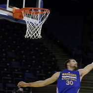 Golden State Warriors' Stephen Curry reaches for the ball during NBA basketball practice, Wednesday, June 3, 2015, in Oakland, Calif. (AP Photo/Ben Margot)