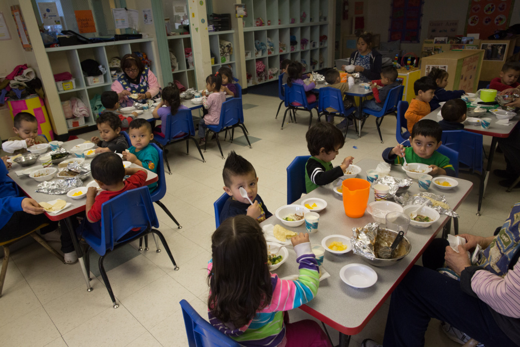 Kids eat lunch at Jardín de Niños in Lincoln Heights. The program provide multi-lingual early education to low-income families.