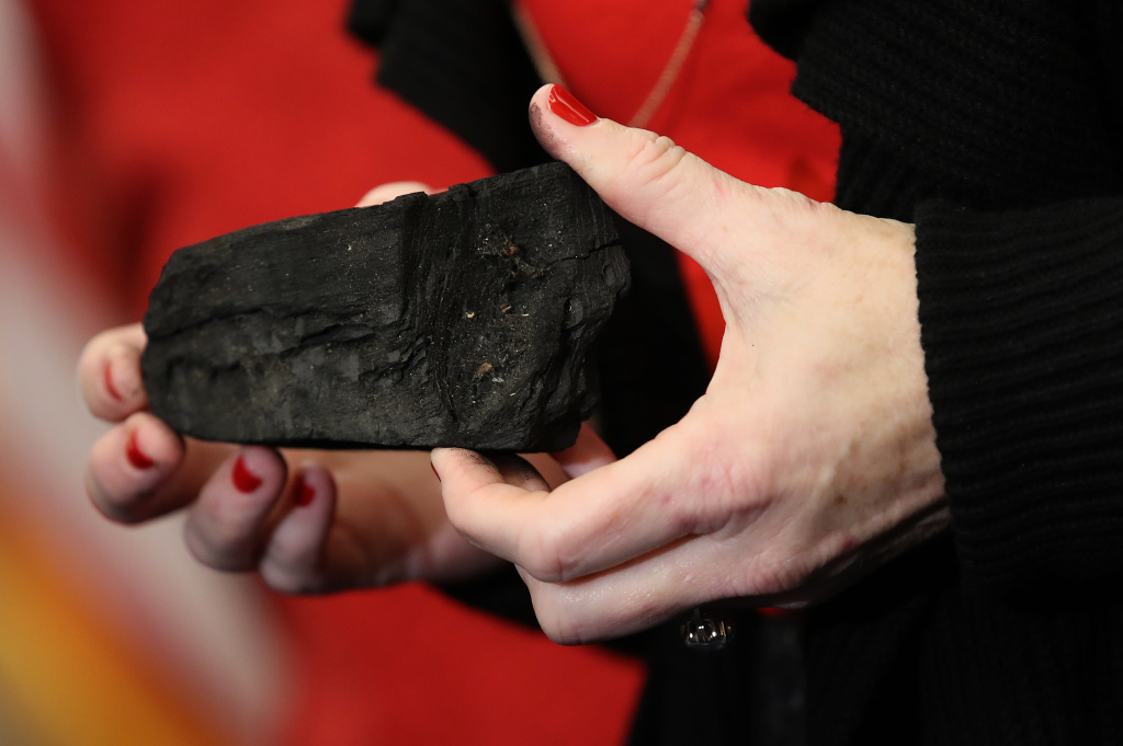 Rep. Kathy Castor (D-FL) holds up a symbolic piece of coal for the holiday season during a press conference on December 20, 2017 in Washington, DC.