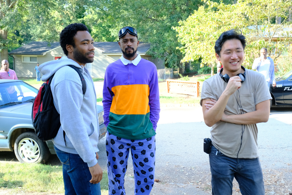 (L-R) Donald Glover as Earnest Marks, Lakeith Stanfield as Darius, director Hiro Murai on the set of