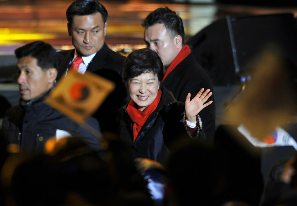 South Korea's president-elect Park Geun-Hye waves to supporters as she arrives to deliver a victory speech on a stage in the centre of Seoul on December 19, 2012. South Korea elected its first female president on December 19, handing a slim but historic victory to conservative ruling party candidate Park Geun-Hye, daughter of the country's former military ruler.