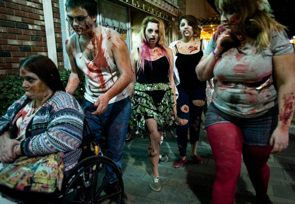 Milania and Beverly Halabi, center, begin a Zombie Walk along Lancaster Boulevard on Friday night.