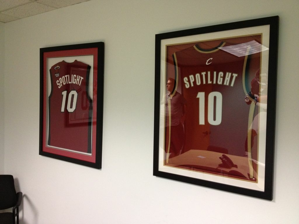 Framed Cleveland Cavaliers and Miami Heat jerseys on the wall at Spotlight TMS in Calabasas