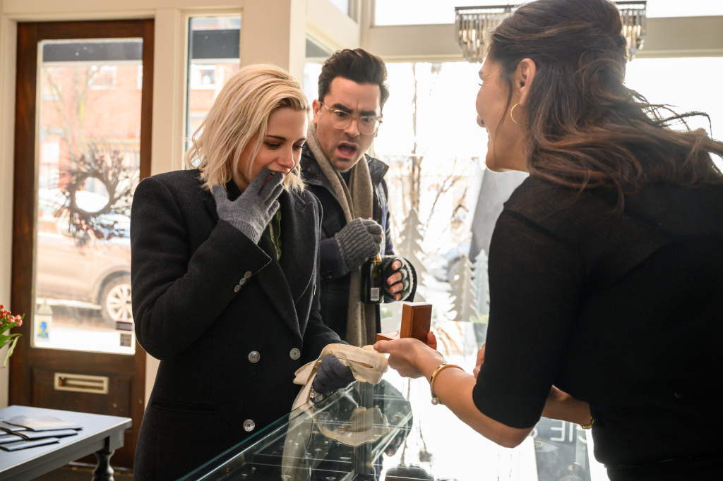 The Jeweler (Sarab Kamoo) shows Abby (Kristen Stewart) rings with John (Dan Levy) in TriStar Pictures' romantic comedy