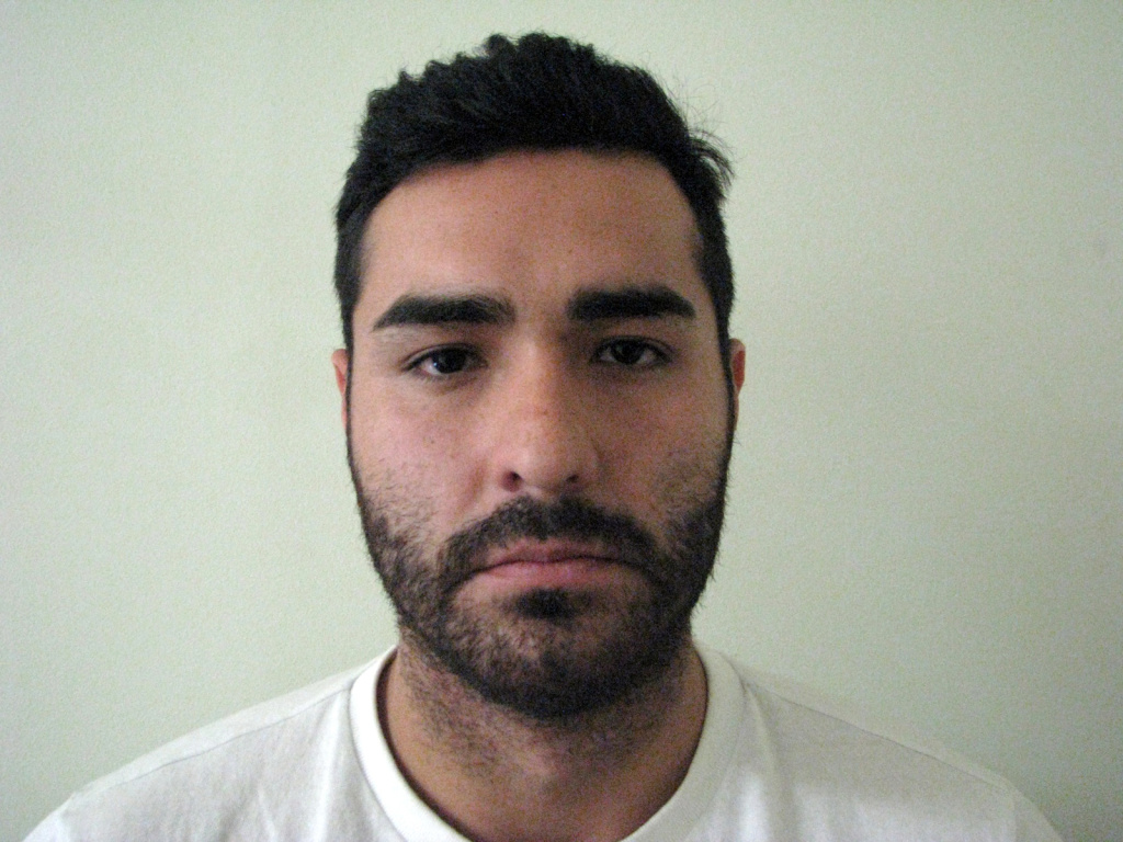 In this photo provided by Mexico's attorney general's office, shows fugitive former Los Angeles police officer Henry Solis, 27, after he was captured by Mexican security forces in the border city of Ciudad Juarez, Mexico, Tuesday, May 26, 2015. Solis was charged with killing a man during an off-duty fight outside a nightclub in Pomona, California on March 13.