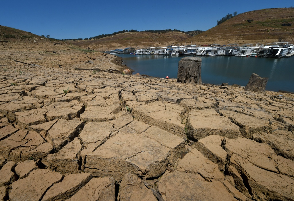 Dried mud and the remnants of a marina is seen at the New Melones Lake reservoir which is now at less than 20 percent capacity as a severe drought continues to affect California on May 24, 2015.         AFP PHOTO/ MARK RALSTON        (Photo credit should read MARK RALSTON/AFP/Getty Images)