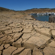 Dried mud and the remnants of a marina is seen at the New Melones Lake reservoir which is now at less than 20 percent capacity as a severe drought continues to affect California on May 24, 2015.