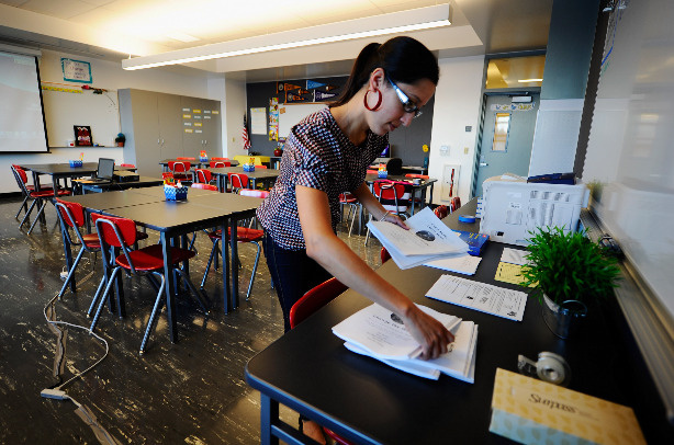 Monique Cruz Garcia, sixth grade english history teacher, prepares her class room at the newly opened Robert F. Kennedy Community Schools complex on September 13, 2010 in Los Angeles, California.