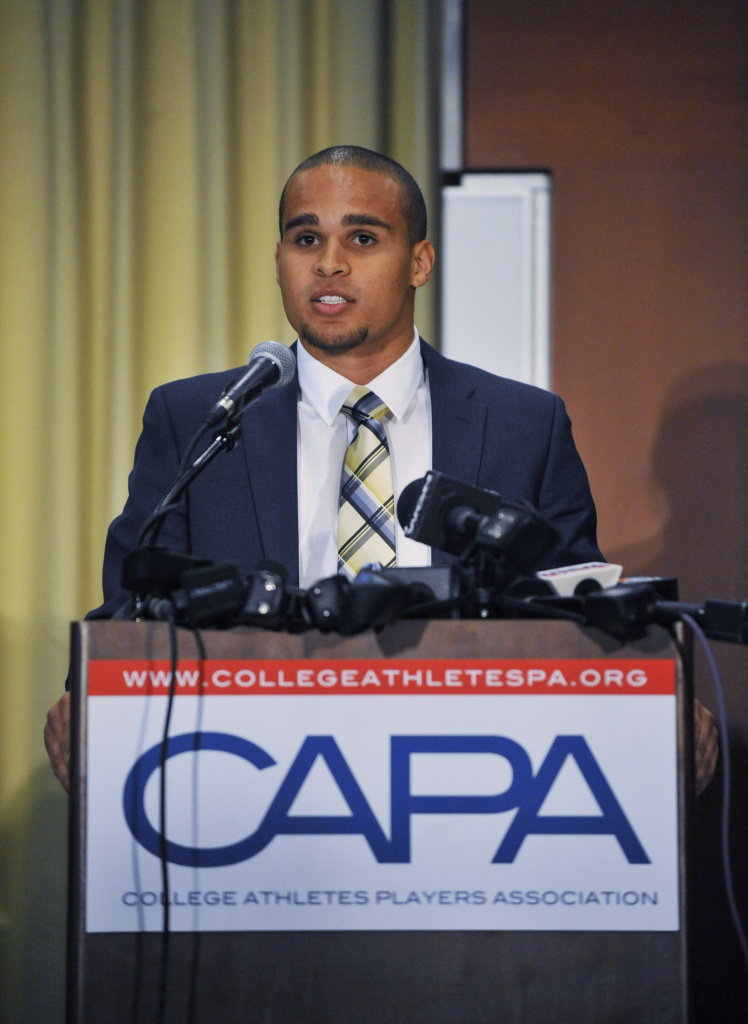 Northwestern quarterback Kain Colter speaks at a press conference on January 28 2014 at  The Hyatt Regency Hotel in Chicago Illinois. Citing what they deem as the NCAA's abdication of responsibility to protect athletes from injury, the College Athletes Association (CAPA) announced the creation of the new labor organization to represent college football and basketball players.