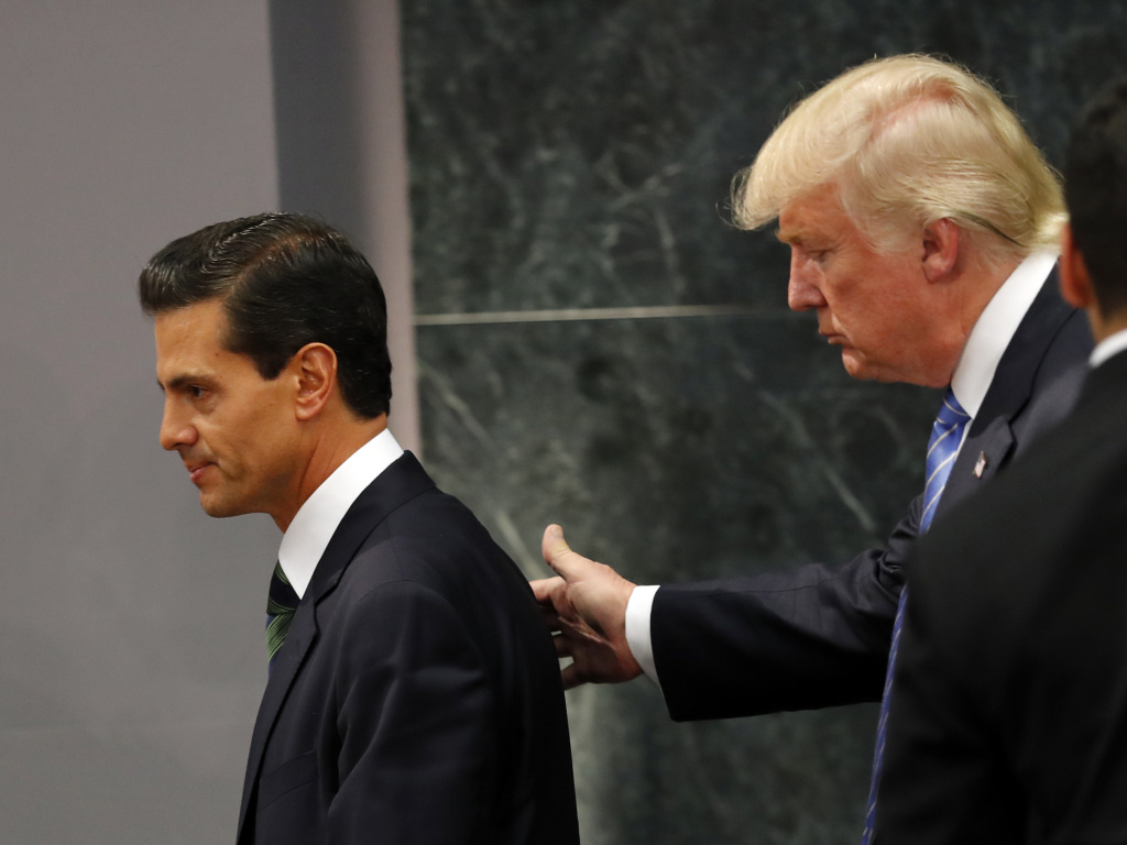 Republican presidential nominee Donald Trump walks with Mexico President Enrique Peña Nieto at the end of their joint statement at Los Pinos, the presidential residence, in Mexico City.