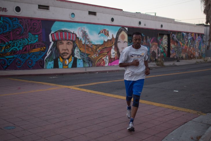 Los Angeles Superior Court Judge Craig J. Mitchell leads the pack of the Midnight Runners across the Sixth Street bridge out of Downtown Los Angeles. The judge agreed to pay for half the costs of two runners to make the trip to Ghana for a marathon.
